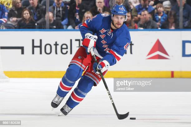 Brendan Smith of the New York Rangers skates with the puck against the Philadelphia Flyers at Madison Square Garden on April 2 2017 in New York City...