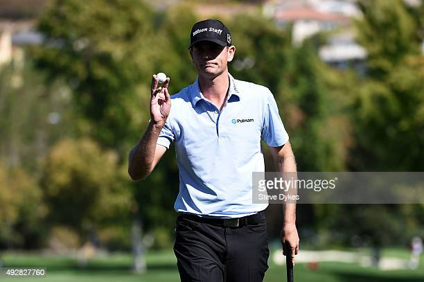 Brendan Steele holds up his ball after putting for birdie on the sixth green during the first round of the Fryscom Open at the North Course of the...
