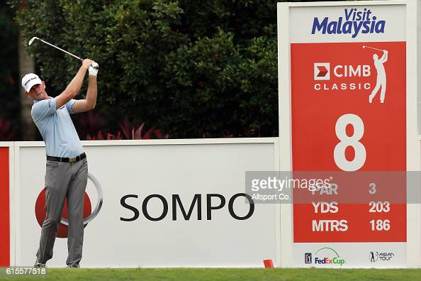 Brendan Steele of the United States tees off on the 8th hole during the ProAm ahead of the 2016 CIMB CLassic at the TPC Club on October 19 2016 in...