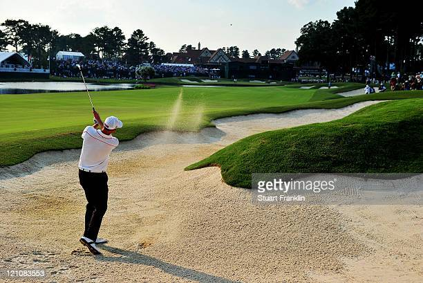 Brendan Steele plays a bunker shot on the 18th hole during the third round of the 93rd PGA Championship at the Atlanta Athletic Club on August 13...