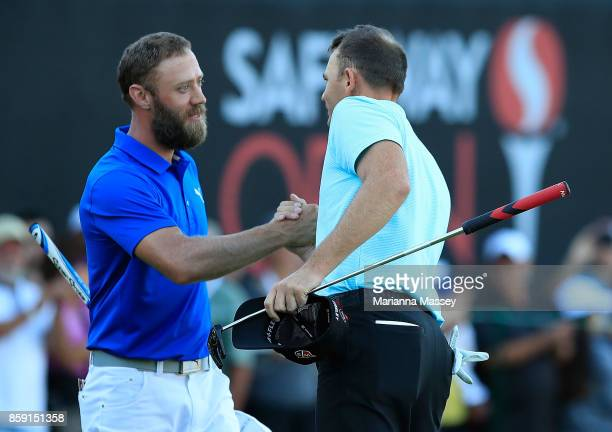 Brendan Steele shakes hands with Graham DeLaet of Canada after finishing his round on the 18th hole during the final round of the Safeway Open at the...