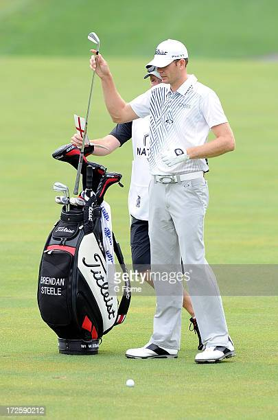 Brendan Steele takes a club out of his bag on the fourth hole during the final round of the ATT National at Congressional Country Club on June 30...