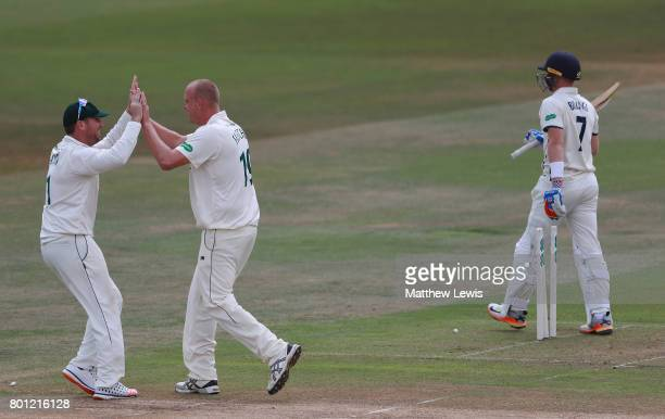 Brendan Taylor of Nottinghamshire congratulates Luke Fletcher after he bowled Sam Billings of Kent during the Specsavers County Championship Division...