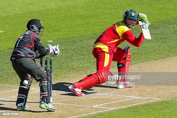Brendan Taylor of Zimbabwe bats past Swapnil Patil of the United Arab Emirates during the 2015 ICC Cricket World Cup match between Zimbabwe and the...
