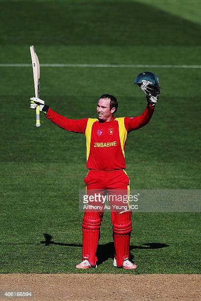 Brendan Taylor of Zimbabwe celebrates after scoring a century during the 2015 ICC Cricket World Cup match between India and Zimbabwe at Eden Park on...