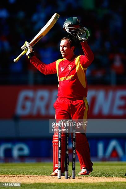 Brendan Taylor of Zimbabwe celebrates his century during the 2015 ICC Cricket World Cup match between India and Zimbabwe at Eden Park on March 14...