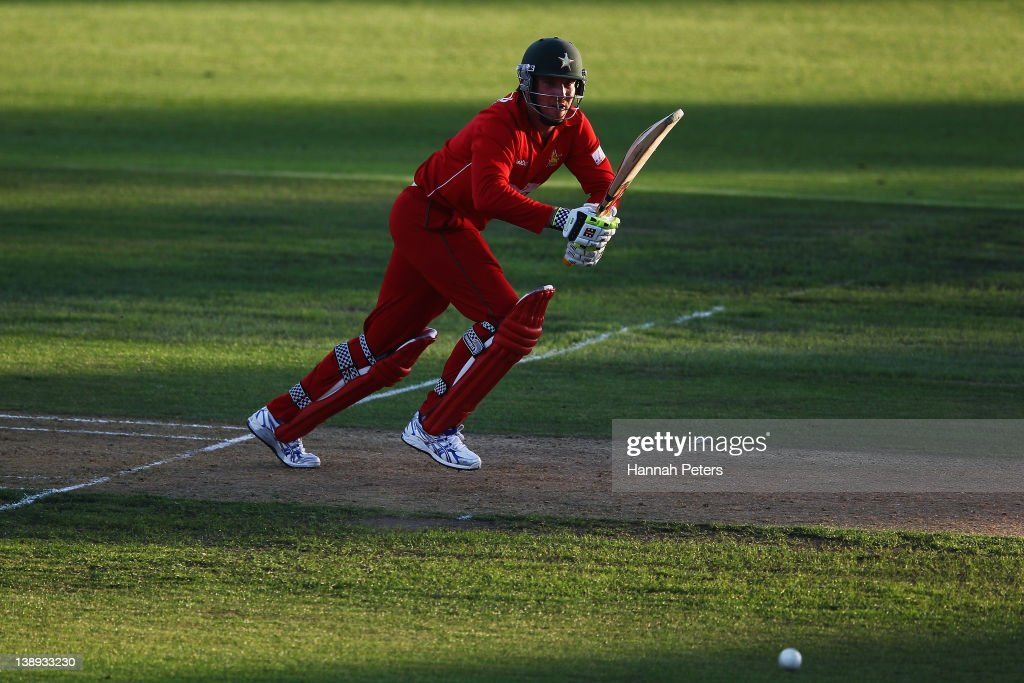 <a gi-track='captionPersonalityLinkClicked' href=/galleries/search?phrase=Brendan+Taylor&family=editorial&specificpeople=798976 ng-click='$event.stopPropagation()'>Brendan Taylor</a> of Zimbabwe drives the ball away for four runs during the second International Twenty20 match between New Zealand and Zimbabawe at Seddon Park on February 14, 2012 in Hamilton, New Zealand.