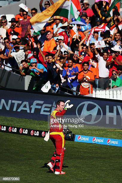 Brendan Taylor of Zimbabwe is congratulated as he comes off the field with the century during the 2015 ICC Cricket World Cup match between India and...