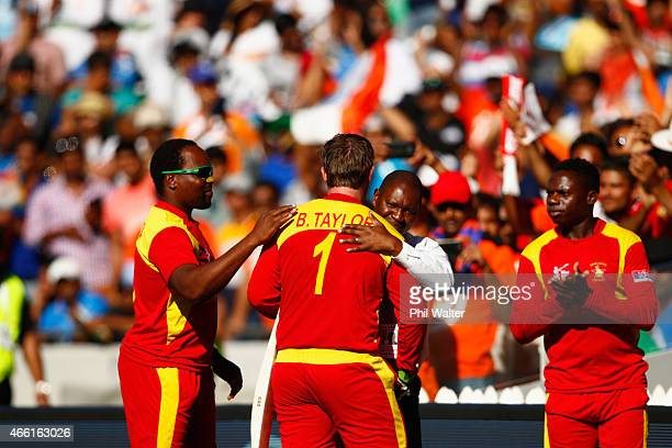 Brendan Taylor of Zimbabwe is congratulated as he leaves the field after making 138 runs during the 2015 ICC Cricket World Cup match between India...