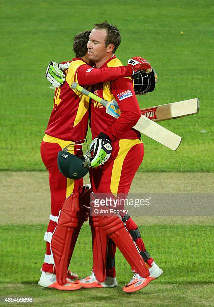 Brendan Taylor of Zimbabwe is congratulated by Sean Williams after making his century during the 2015 ICC Cricket World Cup match between Zimbabwe...