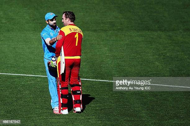 Brendan Taylor of Zimbabwe is congratulated by Virat Kohli of India as he comes off the field with the century during the 2015 ICC Cricket World Cup...