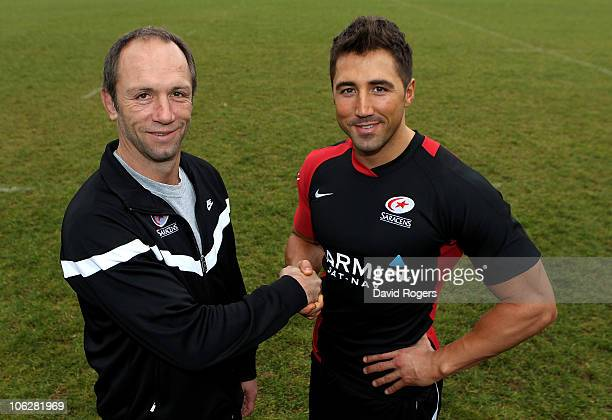Brendan Venter the Saracens director of rugby shakes hands with new signing Gavin Henson during training at Saracens training ground on October 28...