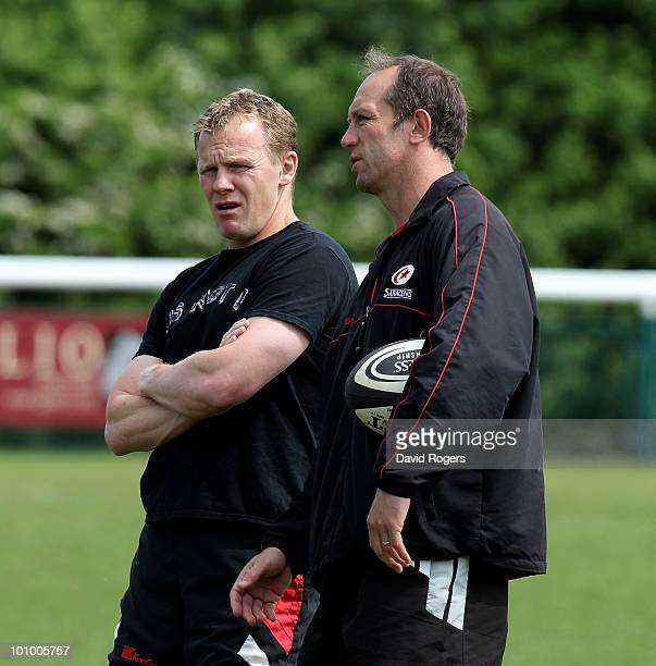 Brendan Venter the Saracens head coach looks on with his assistant Mark McCall during training at the Saracens media day on May 25 2010 in St Albans...