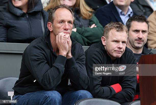 Brendan Venter the Saracens technical director and Mark McCall the director of rugby look dejected after their teams defeat during the Heineken Cup...