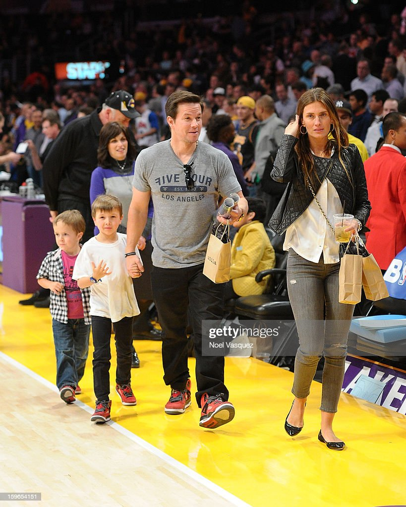 Brendan Wahlberg, Michael Wahlberg, Mark Wahlberg and Rhea Durham attend a basketball game between the Miami Heat and the Los Angeles Lakers at Staples Center on January 17, 2013 in Los Angeles, California.
