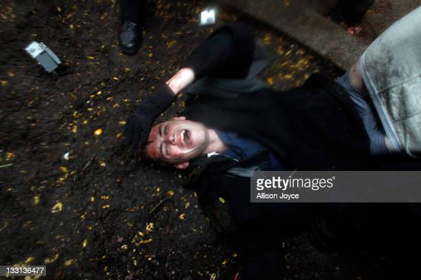 Brendan Watts lies injured on the ground while Occupy Wall Street protesters clash with police in Zuccotti Park on November 17 2011 in New York City...