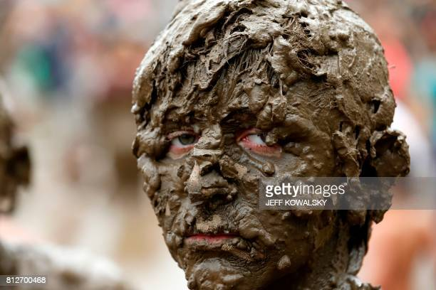 TOPSHOT Brendan Weening of Ypsilanti Michigan plays in the pit at Wayne County's annual Mud Day at Nankin Mills Park on July 11 2017 in Westland...