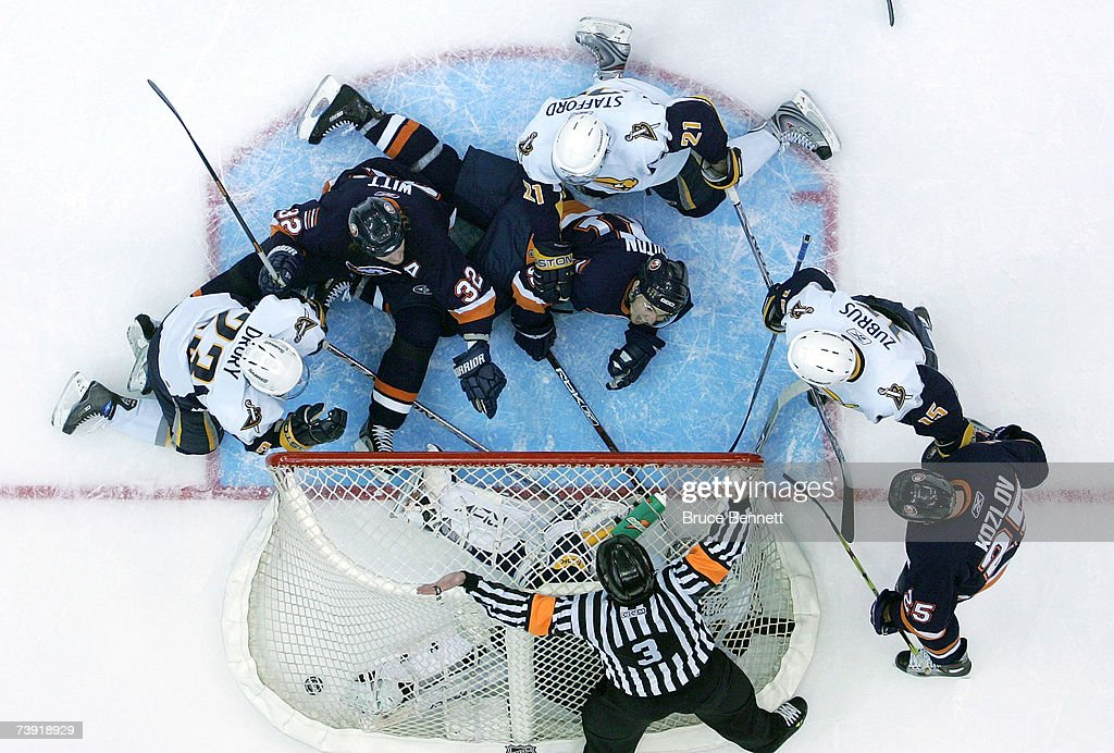 Brendan Witt #32 and Miroslav Satan #81 of the New York Islanders react after referee Mike Leggo blows the whistle signaling no goal after the puck gets past goaltender Ryan Miller #30 of the Buffalo Sabres late in the third period of Game 4 of the 2007 Eastern Conference Quarterfinals on April 18, 2007 at Nassau Coliseum in Uniondale, New York. The Sabres won the game 4-2 and lead the series 3-1.
