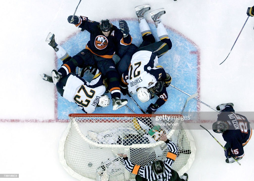 Brendan Witt #32 of the New York Islanders falls back and reacts after referee Mike Leggo blows the whistle signaling no goal after the puck gets past goaltender Ryan Miller #30 of the Buffalo Sabres late in the third period of Game 4 of the 2007 Eastern Conference Quarterfinals on April 18, 2007 at Nassau Coliseum in Uniondale, New York. The Sabres won the game 4-2 and lead the series 3-1.