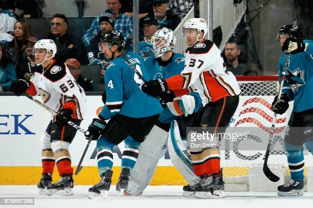 Brenden Dillon and Martin Jones of the San Jose Sharks defend the net against Kevin Roy and Nick Ritchie of the Anaheim Ducks at SAP Center on...