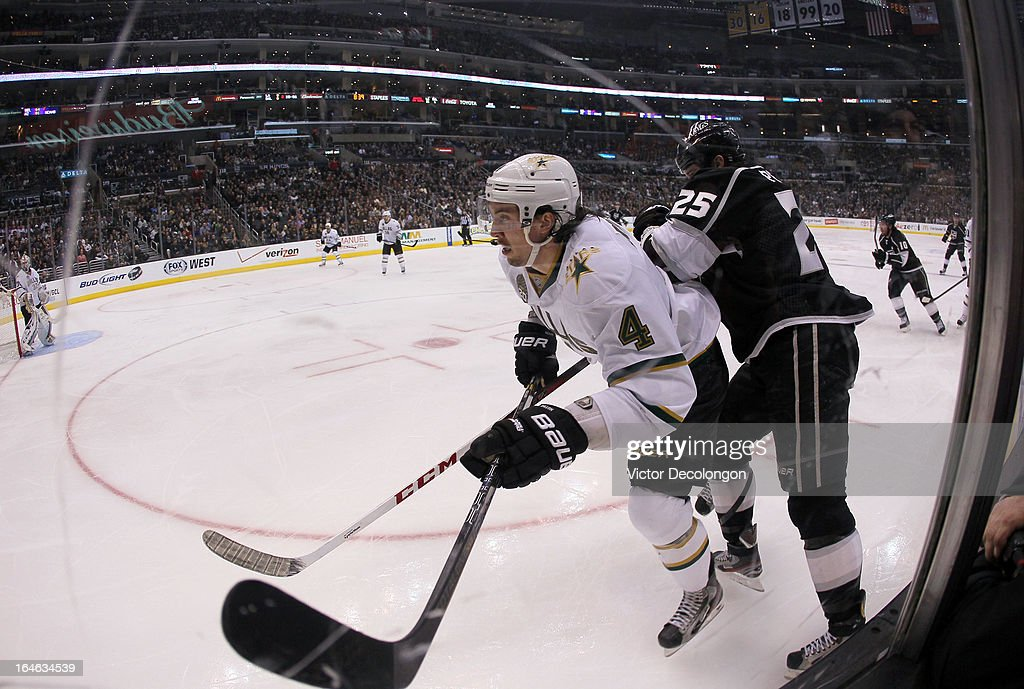 <a gi-track='captionPersonalityLinkClicked' href=/galleries/search?phrase=Brenden+Dillon&family=editorial&specificpeople=6254216 ng-click='$event.stopPropagation()'>Brenden Dillon</a> #4 of the Dallas Stars and <a gi-track='captionPersonalityLinkClicked' href=/galleries/search?phrase=Dustin+Penner&family=editorial&specificpeople=589919 ng-click='$event.stopPropagation()'>Dustin Penner</a> #25 of the Los Angeles Kings vie for position during the NHL game at Staples Center on March 21, 2013 in Los Angeles, California. The Stars defeated the Kings 2-0.