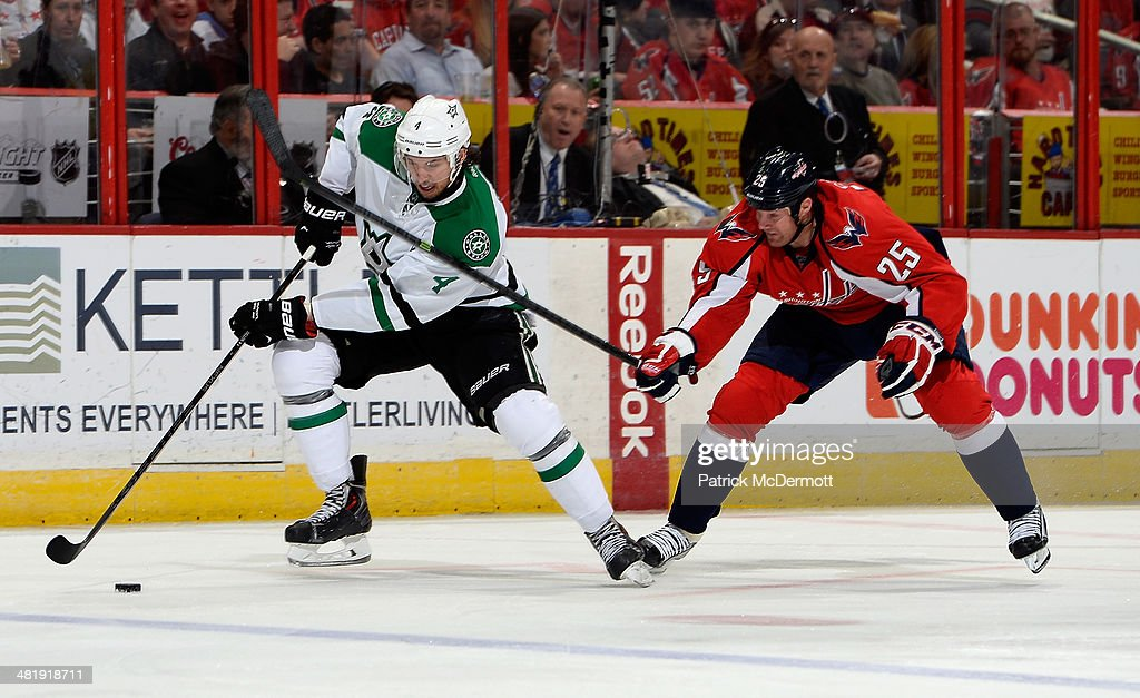 <a gi-track='captionPersonalityLinkClicked' href=/galleries/search?phrase=Brenden+Dillon&family=editorial&specificpeople=6254216 ng-click='$event.stopPropagation()'>Brenden Dillon</a> #4 of the Dallas Stars battles for the puck against <a gi-track='captionPersonalityLinkClicked' href=/galleries/search?phrase=Jason+Chimera&family=editorial&specificpeople=211264 ng-click='$event.stopPropagation()'>Jason Chimera</a> #25 of the Washington Capitals in the second period during an NHL game at Verizon Center on April 1, 2014 in Washington, DC.