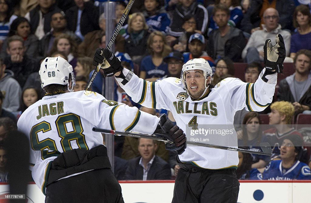 Brenden Dillon #4 of the Dallas Stars celebrates with Jaromir Jagr #86 after scoring what proved to be the game-winning goal against the Vancouver Canucks during the third period in NHL action on February 15, 2013 at Rogers Arena in Vancouver, British Columbia, Canada.