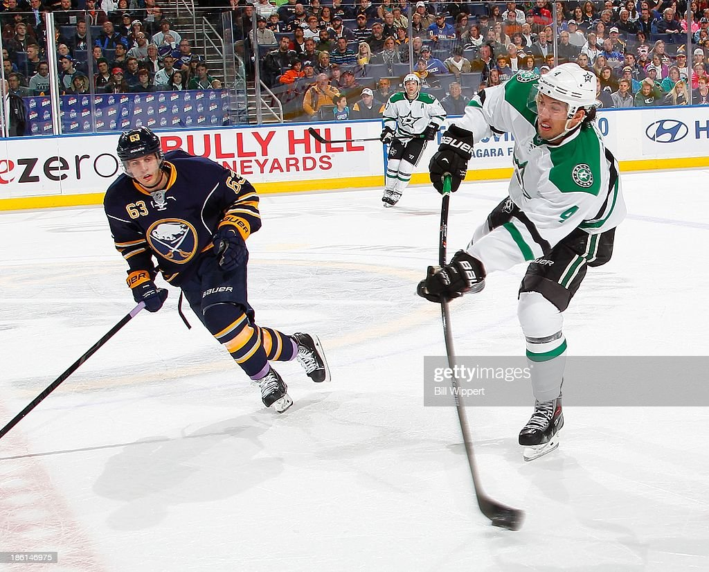 <a gi-track='captionPersonalityLinkClicked' href=/galleries/search?phrase=Brenden+Dillon&family=editorial&specificpeople=6254216 ng-click='$event.stopPropagation()'>Brenden Dillon</a> #4 of the Dallas Stars shoots the puck past <a gi-track='captionPersonalityLinkClicked' href=/galleries/search?phrase=Tyler+Ennis+-+Ice+Hockey+Player&family=editorial&specificpeople=4754184 ng-click='$event.stopPropagation()'>Tyler Ennis</a> #63 of the Buffalo Sabres on October 28, 2013 at the First Niagara Center in Buffalo, New York.