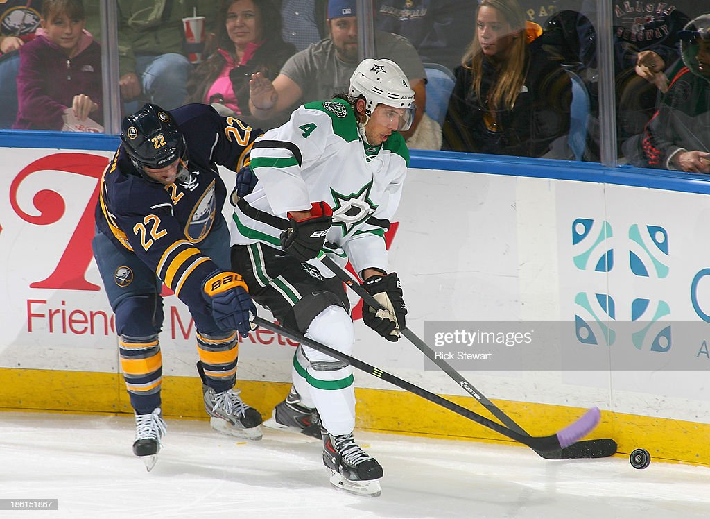 Brenden Dillon #4 of the Dallas Stars skates against Johan Larsson #22 of the Buffalo Sabres at First Niagara Center on October 28, 2013 in Buffalo, New York. Dallas won 4-3.