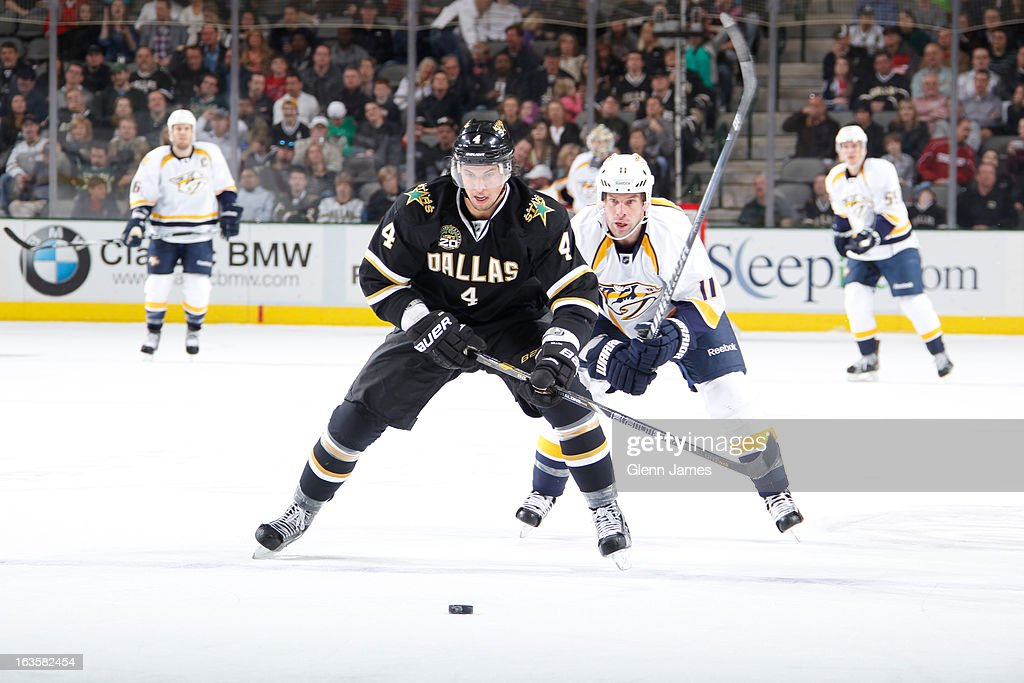 <a gi-track='captionPersonalityLinkClicked' href=/galleries/search?phrase=Brenden+Dillon&family=editorial&specificpeople=6254216 ng-click='$event.stopPropagation()'>Brenden Dillon</a> #4 of the Dallas Stars tries to keep the puck away against <a gi-track='captionPersonalityLinkClicked' href=/galleries/search?phrase=David+Legwand&family=editorial&specificpeople=202553 ng-click='$event.stopPropagation()'>David Legwand</a> #11 of the Nashville Predators at the American Airlines Center on March 12, 2013 in Dallas, Texas.