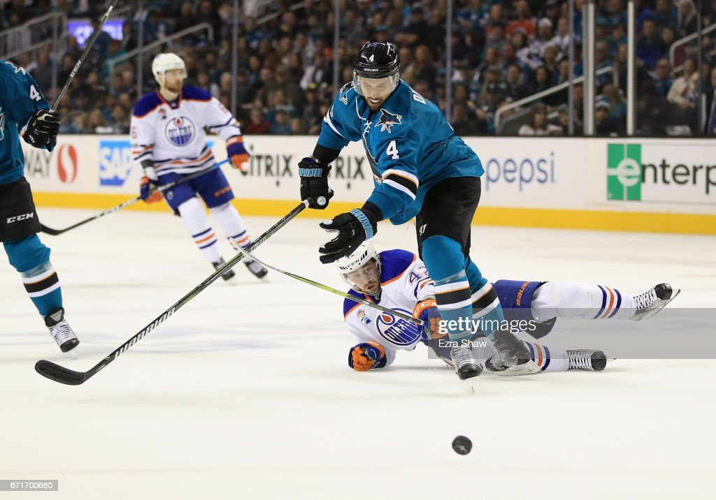 Brenden Dillon #4 of the San Jose Sharks and Anton Slepyshev #42 of the Edmonton Oilers go for the puck during Game Six of the Western Conference First Round during the 2017 NHL Stanley Cup Playoffs at SAP Center on April 22, 2017 in San Jose, California.