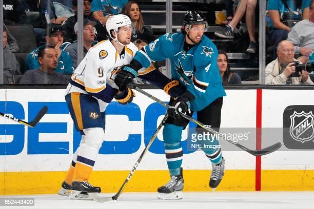 Brenden Dillon of the San Jose Sharks and Filip Forsberg of the Nashville Predators maneuver for position during a NHL game at SAP Center at San Jose...