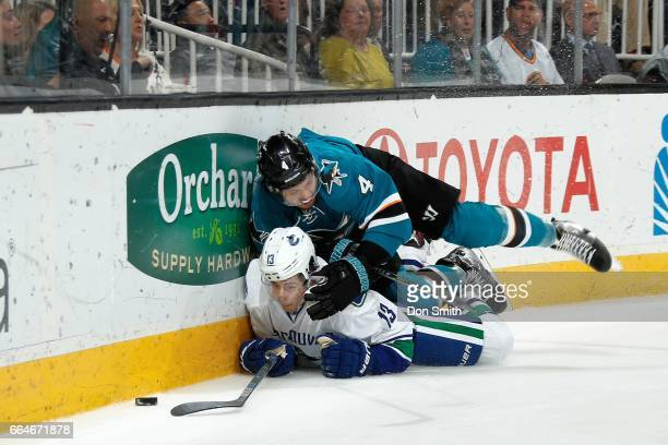 Brenden Dillon of the San Jose Sharks and Griffen Molino of the Vancouver Canucks take a tumble during a NHL game at SAP Center at San Jose on April...