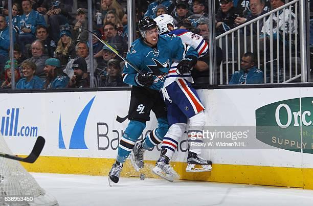 Brenden Dillon of the San Jose Sharks collides into Drake Caggiula of the Edmonton Oilers at SAP Center on December 23 2016 in San Jose California