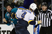 Brenden Dillon of the San Jose Sharks fights with Carl Gunnarsson of the St Louis Blues in game four of the Western Conference Finals during the 2016...