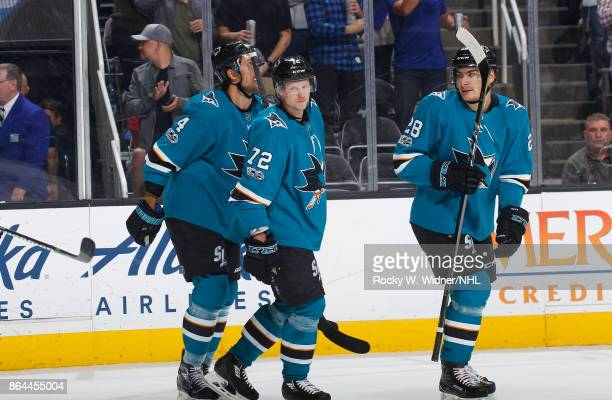 Brenden Dillon Tim Heed and Timo Meier of the San Jose Sharks skate during a NHL game against the Buffalo Sabres at SAP Center on October 12 2017 in...