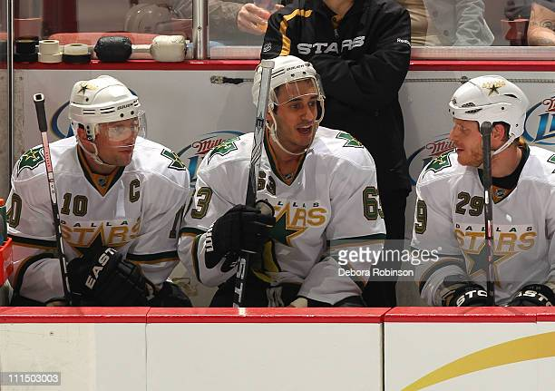 Brenden Morrow Mike Ribeiro and Steve Ott of the Dallas Stars look on from the bench area during the NHL game against the Anaheim Ducks at the Honda...