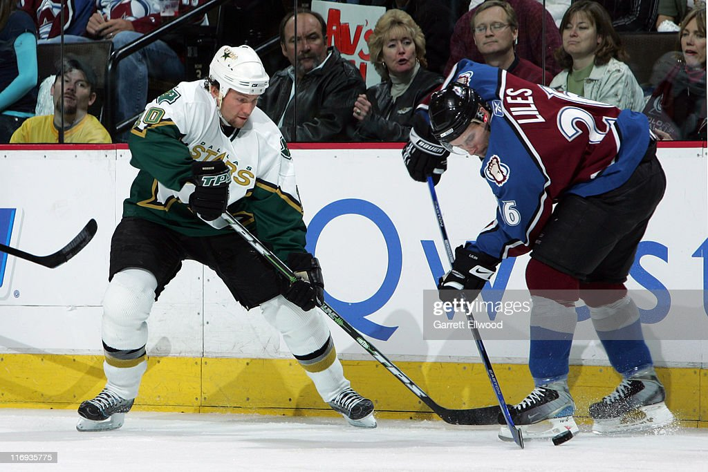 <a gi-track='captionPersonalityLinkClicked' href=/galleries/search?phrase=Brenden+Morrow&family=editorial&specificpeople=202256 ng-click='$event.stopPropagation()'>Brenden Morrow</a> #10 of the Dallas Stars fights for the puck against <a gi-track='captionPersonalityLinkClicked' href=/galleries/search?phrase=John-Michael+Liles&family=editorial&specificpeople=206866 ng-click='$event.stopPropagation()'>John-Michael Liles</a> #26 of the Colorado Avalanche during Game 4 of the Western Conference Quarterfinals on April 28, 2006 at Pepsi Center in Denver, Colorado.