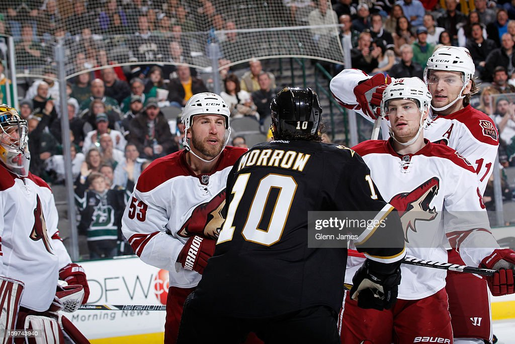 <a gi-track='captionPersonalityLinkClicked' href=/galleries/search?phrase=Brenden+Morrow&family=editorial&specificpeople=202256 ng-click='$event.stopPropagation()'>Brenden Morrow</a> #10 of the Dallas Stars gets into it against <a gi-track='captionPersonalityLinkClicked' href=/galleries/search?phrase=Derek+Morris&family=editorial&specificpeople=204188 ng-click='$event.stopPropagation()'>Derek Morris</a> #53 of the Phoenix Coyotes at the American Airlines Center on January 19, 2013 in Dallas, Texas.
