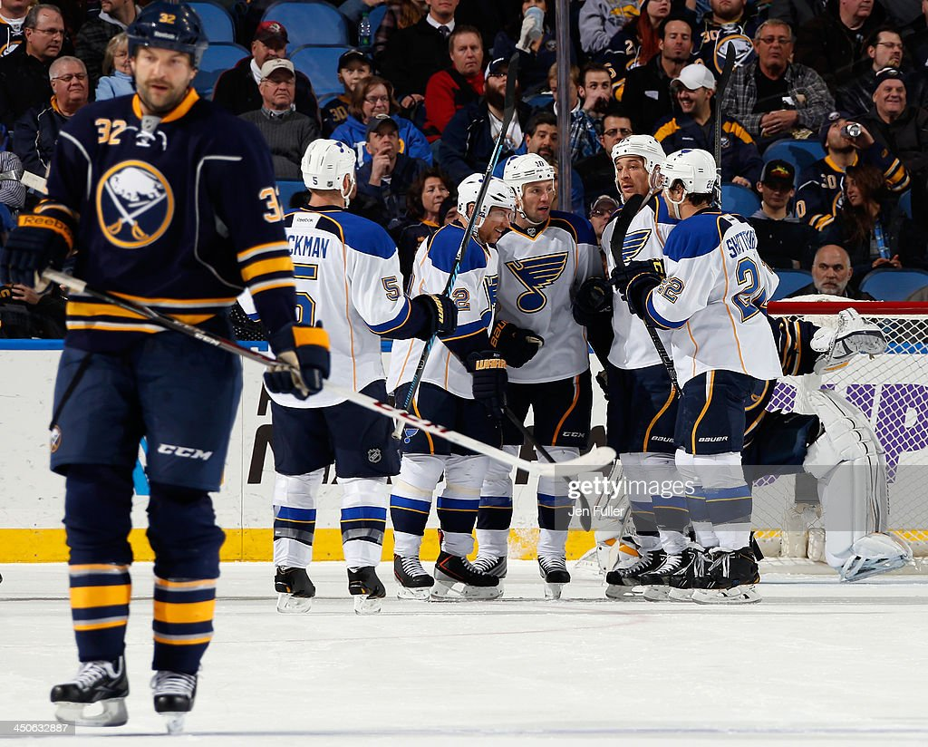 Brenden Morrow #10 of the St. Louis Blues celebrates his second-period goal with teammates Barret Jackman #5, Derek Roy #12 and Kevin Shattenkirk #22 as John Scott #32 of the Buffalo Sabres skates to the bench at First Niagara Center on November 19, 2013 in Buffalo, New York.