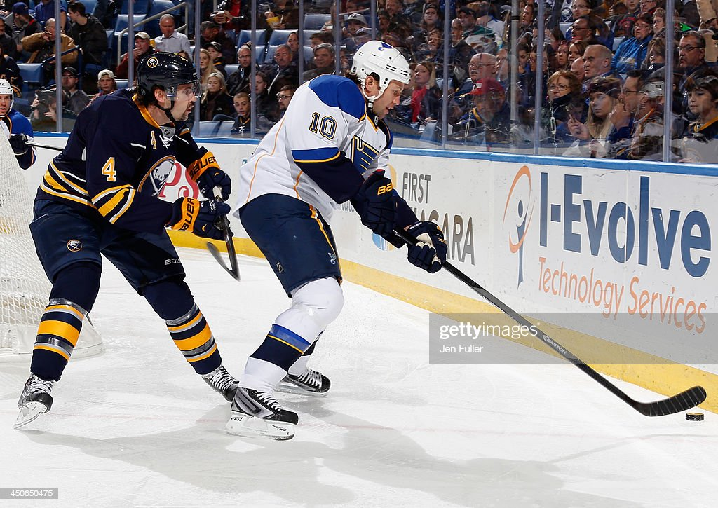 <a gi-track='captionPersonalityLinkClicked' href=/galleries/search?phrase=Brenden+Morrow&family=editorial&specificpeople=202256 ng-click='$event.stopPropagation()'>Brenden Morrow</a> #10 of the St. Louis Blues controls the puck along the boards against <a gi-track='captionPersonalityLinkClicked' href=/galleries/search?phrase=Jamie+McBain&family=editorial&specificpeople=543199 ng-click='$event.stopPropagation()'>Jamie McBain</a> #4 of the Buffalo Sabres at First Niagara Center on November 19, 2013 in Buffalo, New York.