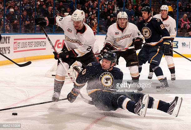 Brenden Morrow of the St Louis Blues falls to the ice while battling for the puck with David Steckel of the Anaheim Ducks during an NHL game on...