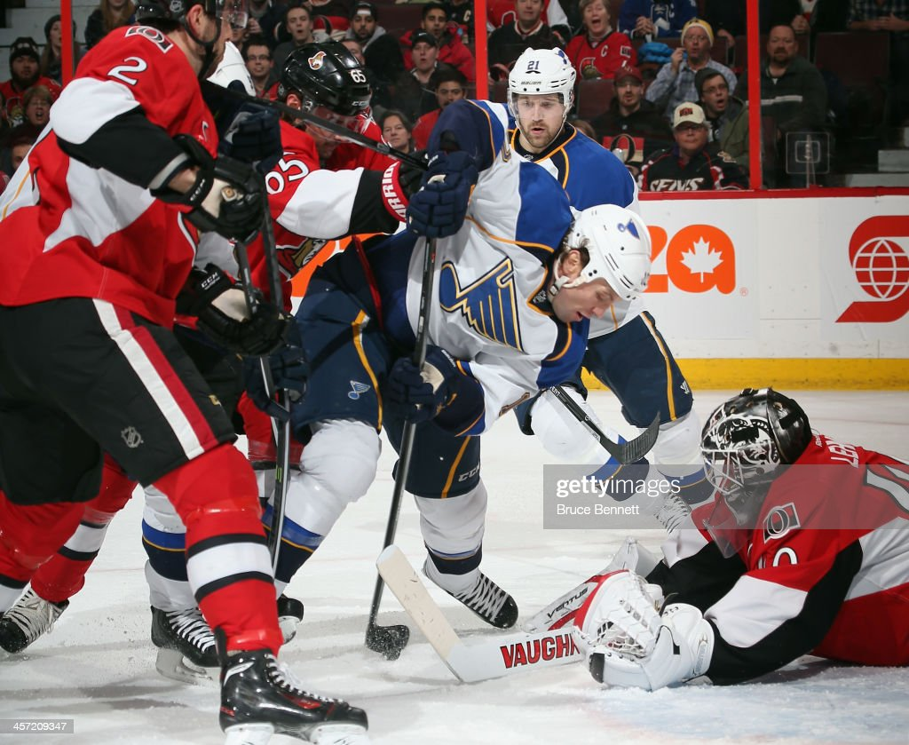 <a gi-track='captionPersonalityLinkClicked' href=/galleries/search?phrase=Brenden+Morrow&family=editorial&specificpeople=202256 ng-click='$event.stopPropagation()'>Brenden Morrow</a> #10 of the St. Louis Blues gets hit in front of <a gi-track='captionPersonalityLinkClicked' href=/galleries/search?phrase=Robin+Lehner&family=editorial&specificpeople=5894610 ng-click='$event.stopPropagation()'>Robin Lehner</a> #40 of the Ottawa Senators during the first period at the Canadian Tire Centre on December 16, 2013 in Ottawa, Canada.
