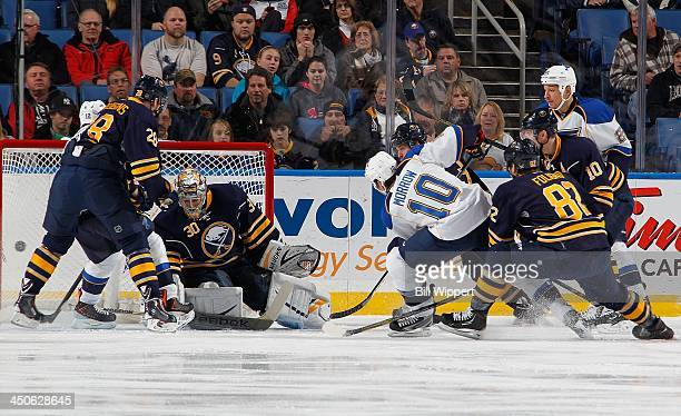 Brenden Morrow of the St Louis Blues scores a firstperiod goal against Ryan Miller of the Buffalo Sabres on November 19 2013 at the First Niagara...