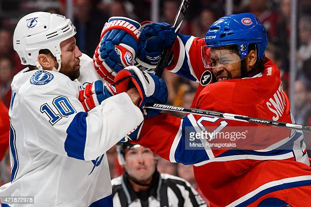 Brenden Morrow of the Tampa Bay Lightning and Devante SmithPelly of the Montreal Canadiens clash in Game One of the Eastern Conference Semifinals...