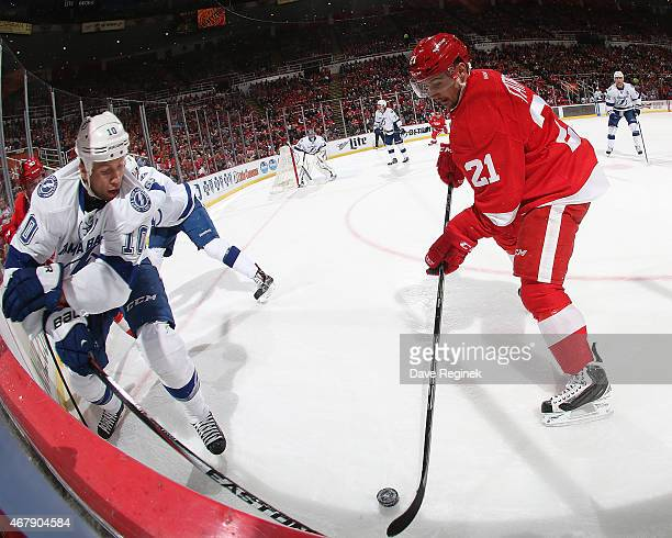 Brenden Morrow of the Tampa Bay Lightning and Tomas Tatar of the Detroit Red Wings battle for the puck in the corner during a NHL game on March 28...