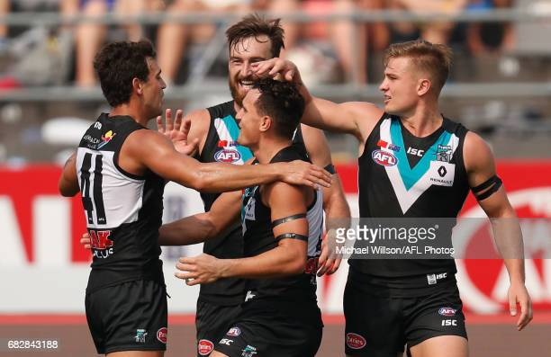 Brendon Ah Chee Charlie Dixon Sam PowellPepper and Ollie Wines of the Power celebrate during the 2017 AFL round 08 match between the Gold Coast Suns...