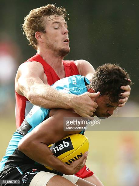 Brendon Ah Chee of the Power is tackled by Luke Parker of the Swans during the 2016 NAB Challenge AFL match between the Sydney Swans and Port...