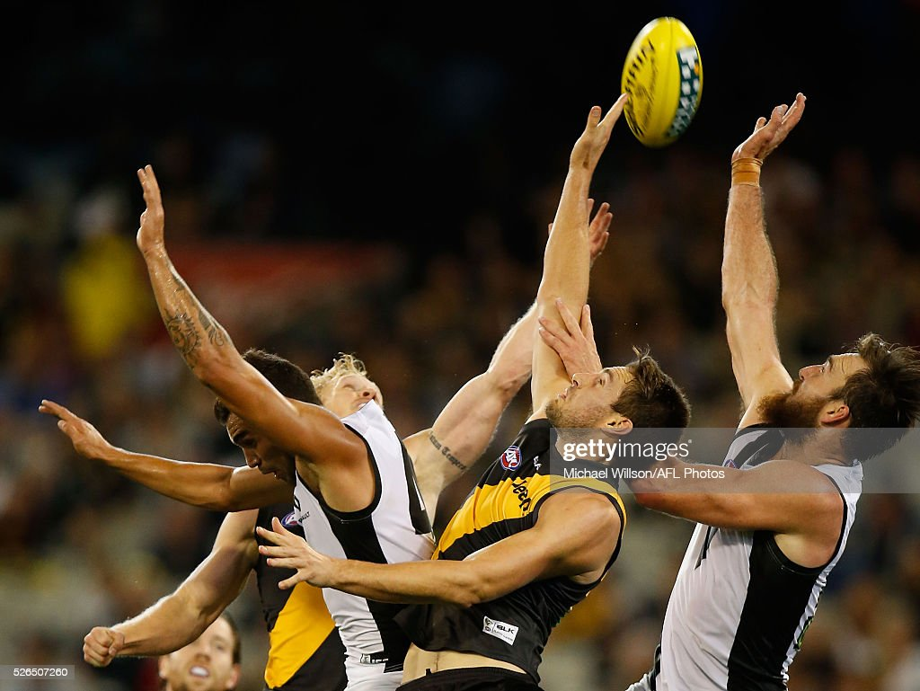 Brendon Ah Chee of the Power (left), Shaun Hampson of the Tigers (centre) and Charlie Dixon of the Power compete for the ball during the 2016 AFL Round 06 match between the Richmond Tigers and Port Adelaide Power at the Melbourne Cricket Ground on April 30, 2016 in Melbourne, Australia.