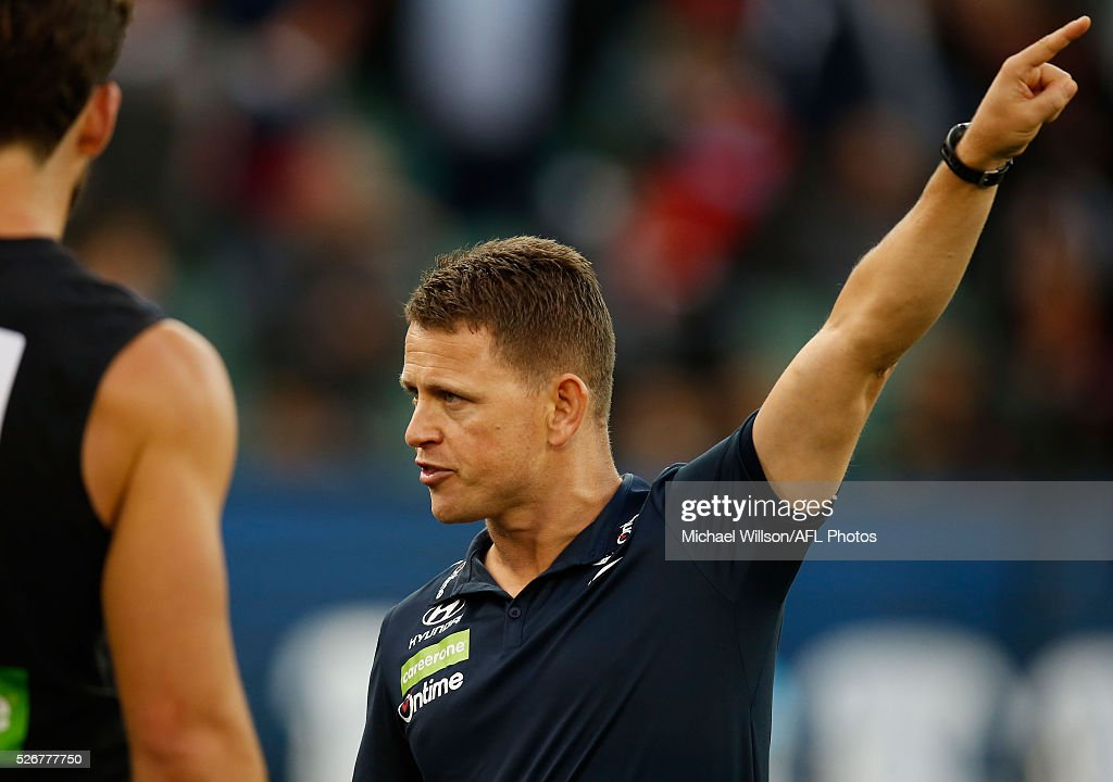 Brendon Bolton, Senior Coach of the Blues addresses his players during the 2016 AFL Round 06 match between the Carlton Blues and the Essendon Bombers at the Melbourne Cricket Ground, Melbourne on May 1, 2016.
